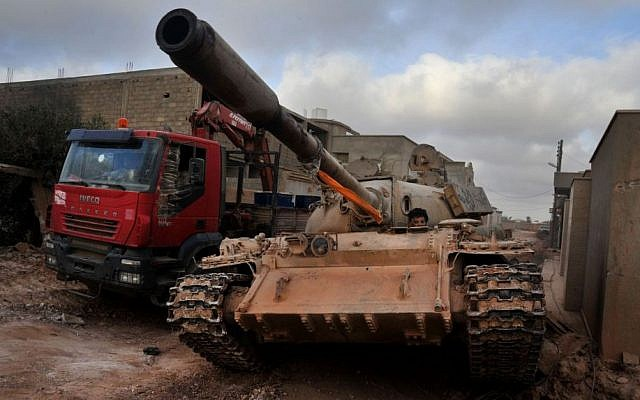 A man loyal to the Libyan armed forces sits in a tank during clashes with Islamic State group militants west of Benghazi, Libya, on Monday, March 7, 2016. (AP/Mohammed el-Shaiky, File)