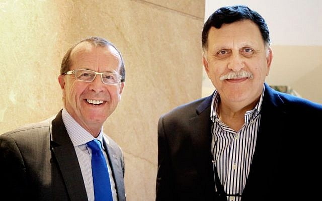 In this Feb. 17, 2016 file photo, UN special envoy for Libya Martin Kobler, left, is greeted by Fayez Serraj, Libyan designated-prime minister and head of the presidential council, in Cairo, Egypt. (AP Photo/Maggie Michael, File)
