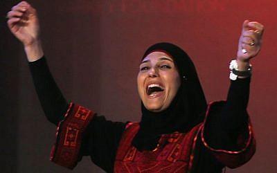 Palestinian primary school teacher Hanan al-Hroub reacts after she won the second annual Global Teacher Prize, in Dubai, United Arab Emirates, March 13, 2016. (AP Photo/Kamran Jebreili, File)