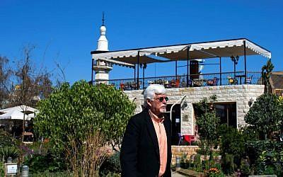 In this picture taken Monday, Feb. 29, 2016, Thomas Webber, 71, walks in garden next to the Citadel of Damascus, Syria. (AP Photo/Hassan Ammar)