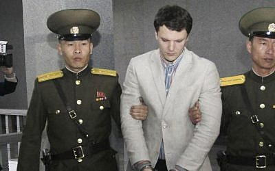 American student Otto Warmbier, center, is escorted at the Supreme Court in Pyongyang, North Korea, March 16, 2016. (AP/Jon Chol Jin)