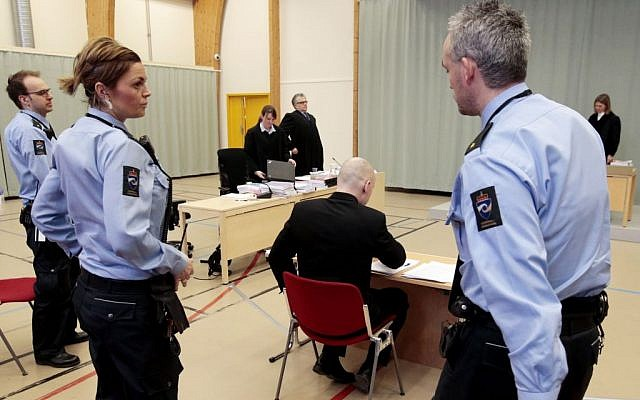 Anders Behring Breivik is surrounded by prison guards after giving his statement at court in Skien, Norway, Wednesday, March 16, 2016. (Lise Aserud/NTB scanpix via AP)
