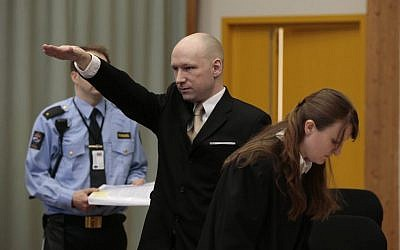 Anders Behring Breivik makes a Nazi gesture as he enters a courtroom in Skien, Norway, on Tuesday, March 15, 2016. (Lise Aserud, NTB scanpix via AP)