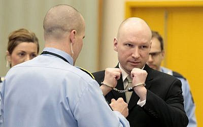 Anders Behring Breivik has his handcuffs removed inside a court room at Skien prison in Skien, Norway, Wednesday, March 16, 2016. (Lise Aserud/NTB scanpix via AP)