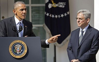 Federal appeals court judge Merrick Garland stands with President Barack Obama as he is introduced as Obama's nominee for the Supreme Court during an announcement in the Rose Garden of the White House, in Washington, Wednesday, March 16, 2016.(AP Photo/Pablo Martinez Monsivais)