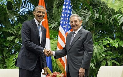 President Barack Obama, left, shakes hands with Cuban President Raul Castro during their meeting at the Palace of the Revolution, in Havana, Cuba, March 21. (AP/Pablo Martinez Monsivais)