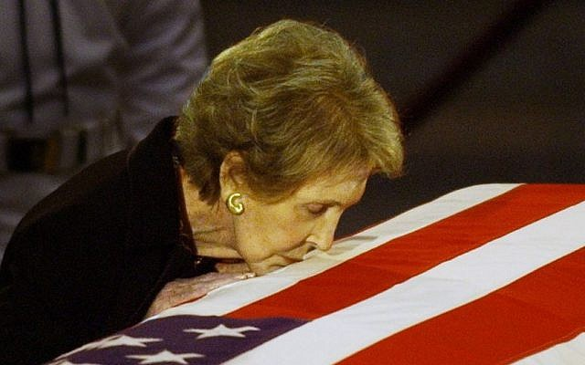 Former first lady Nancy Reagan kisses the casket of her husband former President Ronald Reagan prior to the removal of his remains from the Capitol Rotunda in Washington, June 11, 2004. (AP/Elise Amendola, File)