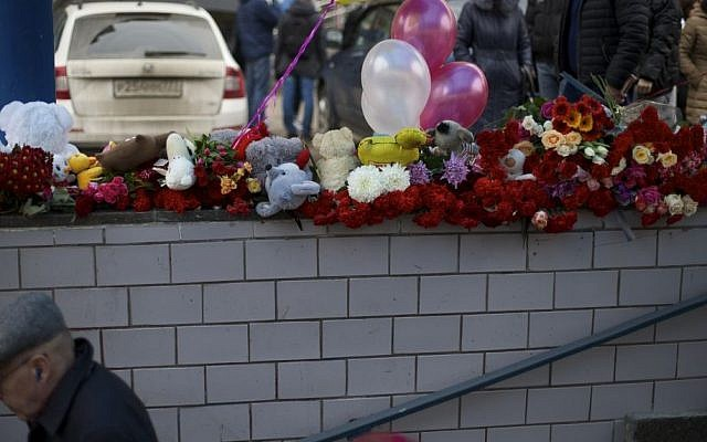 Flowers, children's toys and balloons are seen outside a subway station in Moscow, Russia, on Tuesday, March 1, 2016. (AP Photo/Ivan Sekretarev)