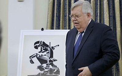 US Ambassador John Tefft speaks at a ceremony at the ambassador's residence in Moscow, Russia, Thursday, March 3, 2016, during which the US returned nearly 30 stolen archival documents from the 18th and 19th centuries to the Russian government. (AP Photo/Ivan Sekretarev)