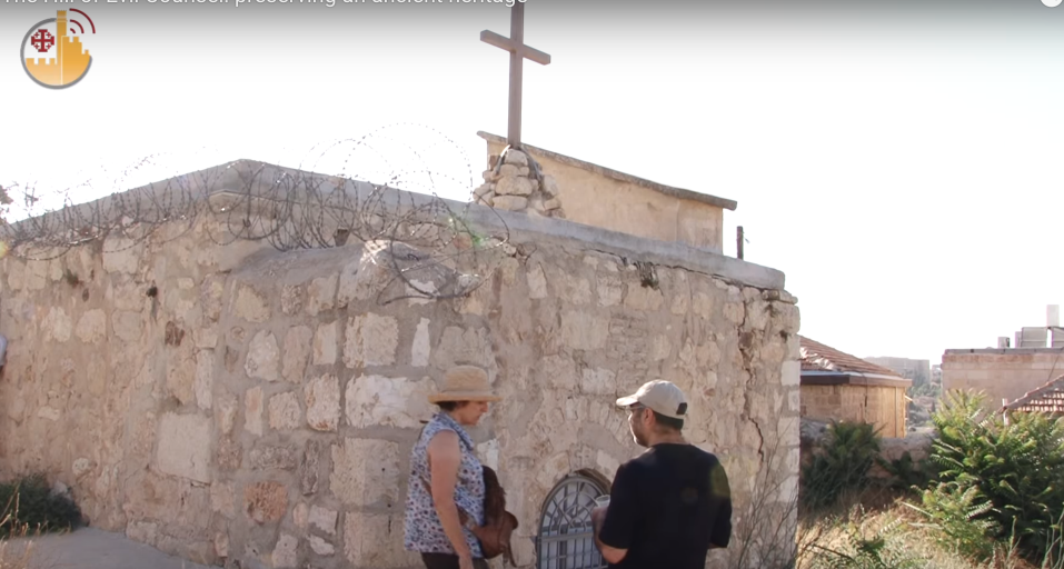 Visitors tour a Christian site at Jerusalem's Hill of Evil Counsel in Abu Tor (YouTube screenshot)