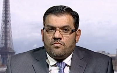 Anas al-Abda speaks to Al Jazeera in 2011 (screen capture: YouTube)