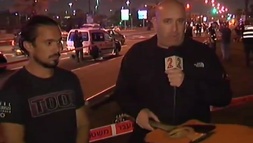 Yishay Montgomery (left) and the guitar with which he tried to thwart a Palestinian terrorist in Jaffa on March 8, 2016 (Channel 2 screenshot)