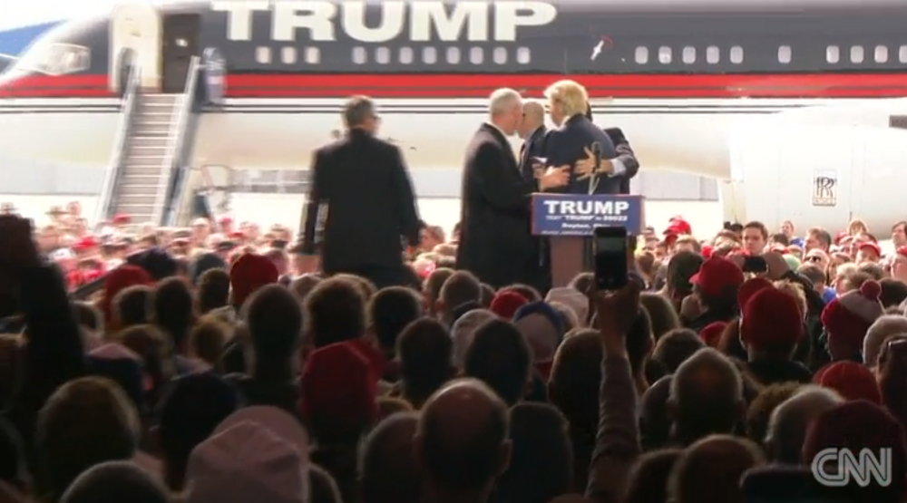 Trump jolts is surrounded by security guards in false alarm at security guards rush the stage to surround donald trump dayton ohio march 12 publicscrutiny Image collections