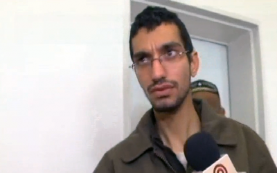 Majd Ouida, a 22-year-old Gazan who Israel has indicted for hacking into IDF drone feeds, traffic cameras and other Israeli computer systems, in a Beersheba court on March 23, 2016. (Screen capture: Channel 10)