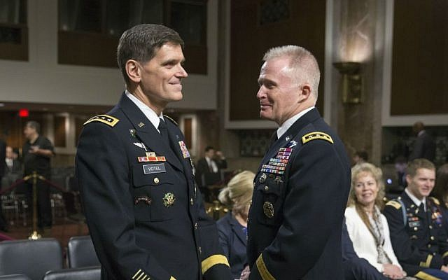 Gen. Joseph L. Votel, currently the head of the Special Operations Command, left, and Lt. Gen. Raymond A. Thomas III, arrive on Capitol Hill in Washington, Wednesday, March 9, 2016, to testify before the Senate Armed Services Committee confirmation hearing to elevate their positions. (AP Photo/J. Scott Applewhite)