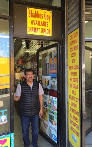 "Arvind Patel, a Hindu convenience store owner in Queens who calls himself ""the original Shabbos goy,"" greets many Jewish customers with well wishes in Hebrew. (Uriel Heilman)"
