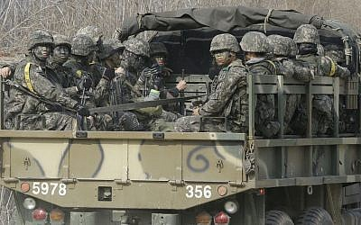 South Korean army soldiers ride on the back of a truck in Paju, near the border with North Korea, Thursday, March 3, 2016. (AP Photo/Ahn Young-joon)