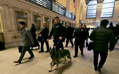 Metro-North Railroad police officers with a police dog patrol at Grand Central Terminal, in New York, on March 22, 2016. (AP/Richard Drew, File)