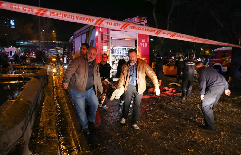 People carry an injured person after an explosion in the busy center of Turkish capital, Ankara, Turkey, Sunday, March 13, 2016. (AP)