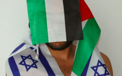 Khader Abu-Seif draped in opposing flags for part of the Celebration series by photographer Xavier Klaine (Courtesy Xavier Klaine)
