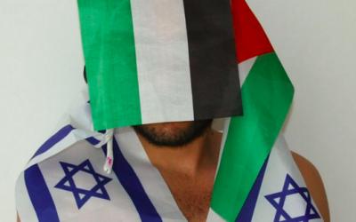 Khader Abu-Seif draped in opposing flags for part of the Celebration series by photographer Xavier Klaine (Courtesy Xavier Klaine)