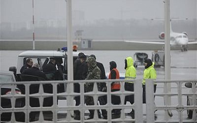 Russian emergency officials and police are seen as they prepare to drive to the area of a plane crash at the Rostov-on-Don airport, about 950 kilometers south of Moscow on March 19, 2016. (AP Photo)