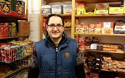 Tehran native Kambiz Alizadeh at his Getränkemarkt Beethoven convenience store near the Roonstrasse synagogue in Cologne, Germany (Raphael Ahren/TOI)