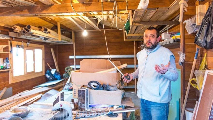 Carpenter Sergey Yarelchenko at his workshop in the Jewish refugee community of Anatevka, near Kiev, March 13, 2016. (Cnaan Liphshiz)