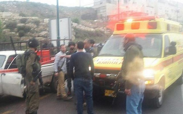 IDF and rescue services at the scene of a Palestinian attack outside Kiryat Arba in the West Bank on Monday, March 14, 2016 (Hatzolah)