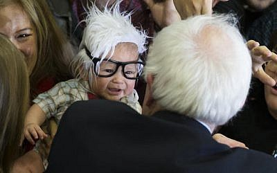 FILE - In this Sunday, Feb. 14, 2016 file photo, Democratic presidential candidate Sen. Bernie Sanders, I-Vt., right, meets Oliver Jack Carter Lomas-Davis, of Venice, Calif., who was dressed as Sanders during a rally at Bonanza High School in Las Vegas. (AP Photo/Evan Vucci, File)