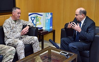 US Chairman of the Joint Chiefs of Staff Joseph Dunford speaks with Defense Minister Moshe Ya'alon in his office at the ministry's Tel Aviv headquarters on March 3, 2016. (Ariel Hermoni/Defense Ministry)