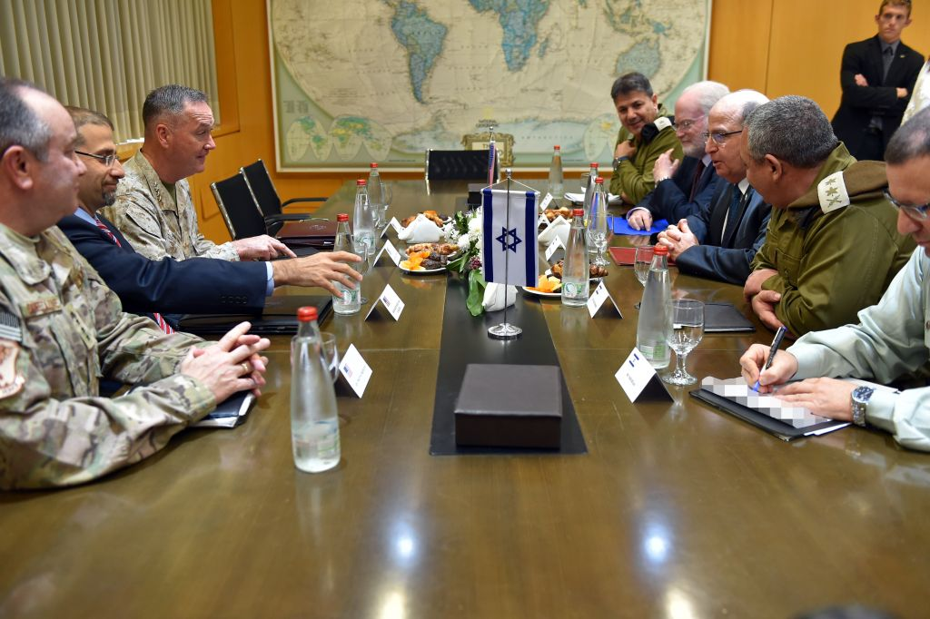 Representatives from the United States, including Chairman of the Joint Chiefs of Staff Joseph Dunford and Ambassador Dan Shapiro, meet with Israeli defense officials, including Defense Minister Moshe Ya'alon and IDF Chief of Staff Gadi Eisenkot, in the Defense Ministry's Tel Aviv headquarters on March 3, 2016. (Ariel Hermoni/Defense Ministry)