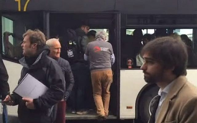 Passengers board buses after they were evacuated from Brussels following twin blasts on March 22, 2016 (screen capture: YouTube)
