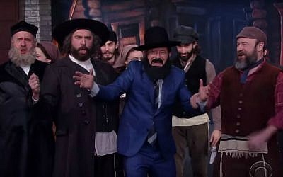 "Comedian Stephen Colbert sings with the cast of the Broadway revival of ""Fiddler on the Roof,"" March 1, 2016. (YouTube screen capture)"