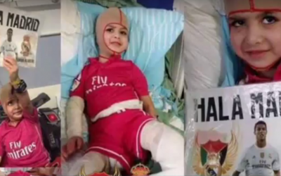 In this screen capture from a YouTube video uploaded on March 16, 2016, Ahmed Dawabsha is seen recovering from his burns in hospital, holding a Real Madrid sign. (YouTube screen capture)
