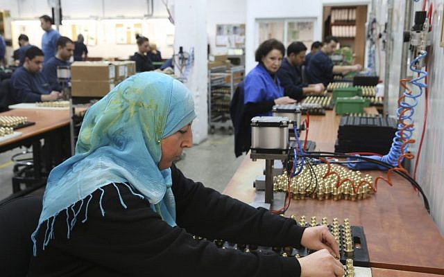 A Palestinian woman works at a SodaStream factory on February 2, 2014 in the Mishor Adumim industrial park, next to the Maale Adumim. (Nati Shohat/Flash90)