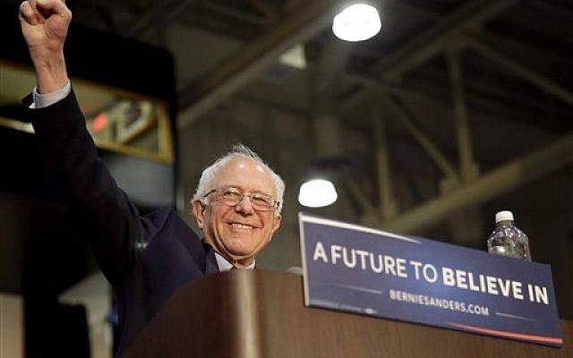Democratic presidential candidate Sen. Bernie Sanders, I-Vermont, greets his supporters as he arrives at Grand Valley State University Field House Arena in Allendale, Michigan, Friday, March 4, 2016. (AP Photo/Nam Y. Huh)