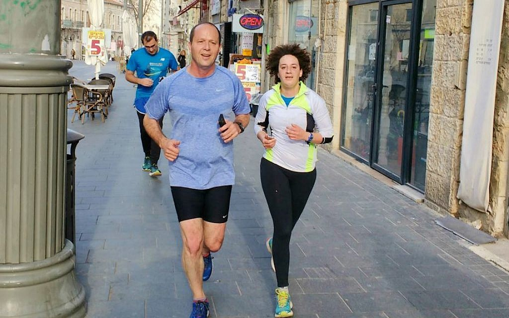 Melanie Lidman joined Jerusalem mayor Nir Barkat on one of his regular morning jogs from his house to the municipality office on February 10, 2016. (Melanie Lidman/Times of Israel)
