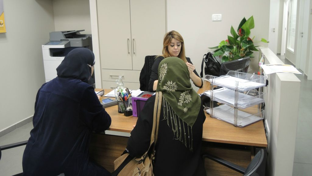 Two women meet with an employment counselor in the Rayan employment center in Nazareth on March 3, 2016. (Melanie Lidman/Times of Israel)