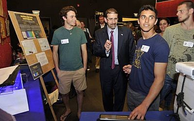 US Ambassador to Israel Dan Shapiro (center) reviews projects at the Gaia Symposium, February 25, 2016 (Amir Ezer)
