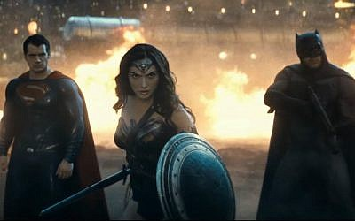 Gal Gadot as Wonder Woman, flanked by Ben Affleck's Batman (right) and Henry Cavill's Superman (left). (YouTube screenshot)
