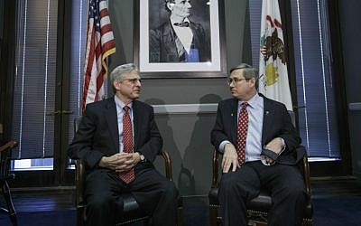 Sen. Mark Kirk, R-Ill., right, meets with Judge Merrick Garland, President Barack Obama's choice to replace the late Justice Antonin Scalia on the Supreme Court, becoming the only Republican senator to meet the embattled nominee, Tuesday, March 29, 2016, on Capitol Hill in Washington. (AP Photo/J. Scott Applewhite)
