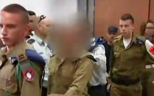 The IDF soldier who shot a disarmed Palestinian attacker in the head in Hebron appears in Qastina military court on March 31, 2016 (screen capture: Channel 2)