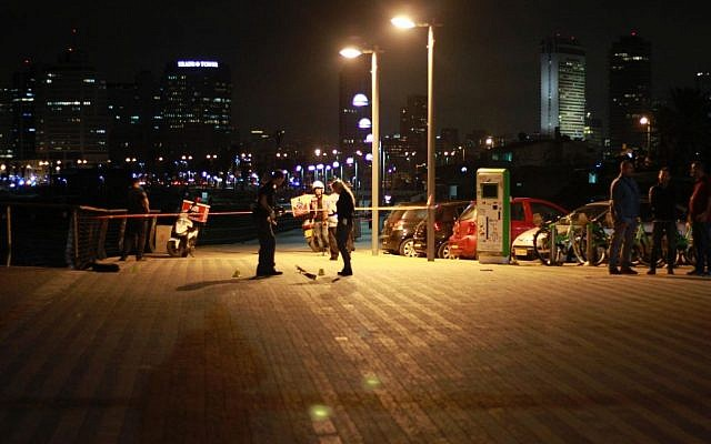 Security forces at the scene of a stabbing attack in which one person was killed and nine others were injured at the Jaffa Port on March 8, 2016. (Judah Ari Gross/Times of Israel)