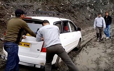 Illustrative image of a car stuck in mud. (screen capture: YouTube)