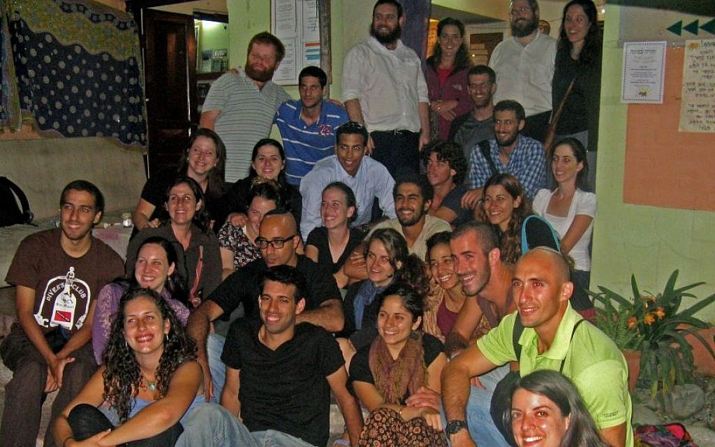 Rabbi Chezki Lifshitz, left in upper row, with hikers at the Chabad House of Kathmandu, March 2012. (Courtesy of Chabad Nepal)