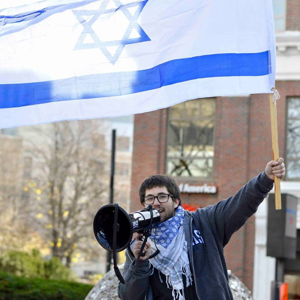 Brandeis University pro-Israel student activist Seth Greenwald agitates during a 'Fuel for Truth' march in November of 2015, in Boston (courtesy)