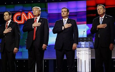 Republican presidential candidates (from left) Sen. Marco Rubio, R-Fla., Donald Trump, Sen. Ted Cruz, R-Texas, and Ohio Gov. John Kasich, stand together during the singing of the National Anthem, before the start of the Republican presidential debate at the University of Miami, Thursday, March 10, 2016, in Coral Gables, Florida (AP Photo/Wilfredo Lee)
