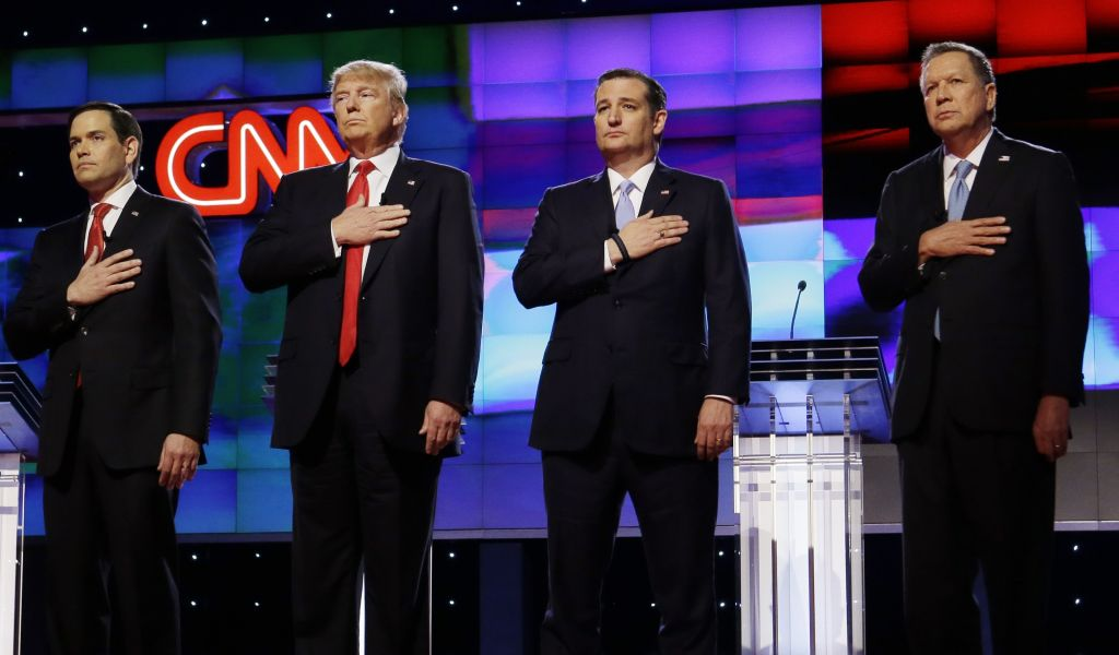 Republican presidential candidates (from left) Sen. Marco Rubio, R-Fla., Donald Trump, Sen. Ted Cruz, R-Texas, and Ohio Gov. John Kasich, stand together during the singing of the National Anthem, before the start of the Republican presidential debate sponsored by CNN, Salem Media Group and the Washington Times at the University of Miami, Thursday, March 10, 2016, in Coral Gables, Florida (AP Photo/Wilfredo Lee)