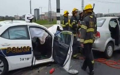 Firefighters at the scene of a crash between a police car and a second vehicle as officers pursued a stolen vehicle driving against traffic, March 26, 2016 (Channel 2 news)